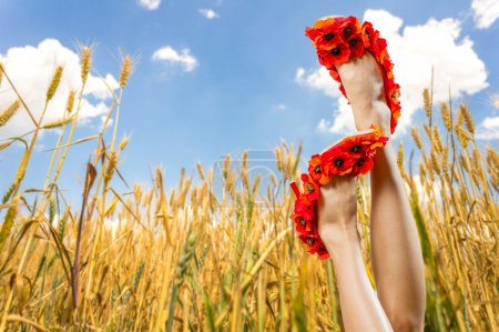 Photo for Sexy woman legs in funny shoes on blue sky and wheat field background. Summer vacation concept - Royalty Free Image