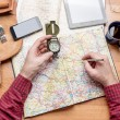 Travel planning - hands of a man with city trip tr...