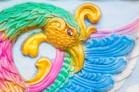 closeup traditional colorful artwork of the mythical bird phoeni