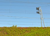 Railway embankment, traffic light and wires