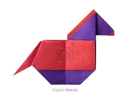 Foto de Origami papel arte dibujos animados simbol caballo sobre un fondo blanco - Imagen libre de derechos