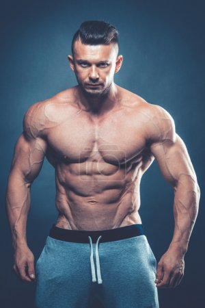 Strong Athletic Man Fitness Model Torso showing six pack abs. is