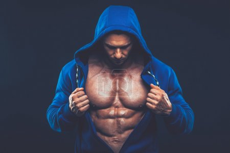Photo for Man with muscular torso. Strong Athletic Man Fitness Model Torso showing six pack abs fighter  kickbox boxer boxing fight - Royalty Free Image