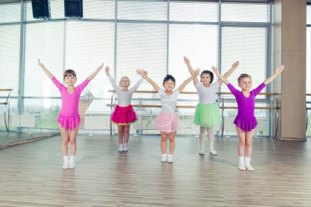 happy children dancing on in hall, healthy life, kids togetherness and happiness concept