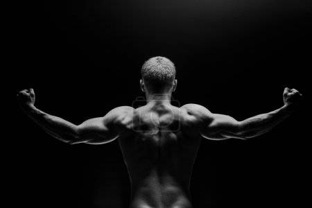 Close up of sports mans muscular isolated on black background