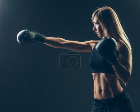 beautiful woman with the red boxing gloves,black background