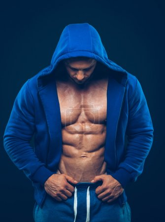 Photo for Man with muscular torso. Strong Athletic Man Fitness Model Torso showing six pack abs - Royalty Free Image