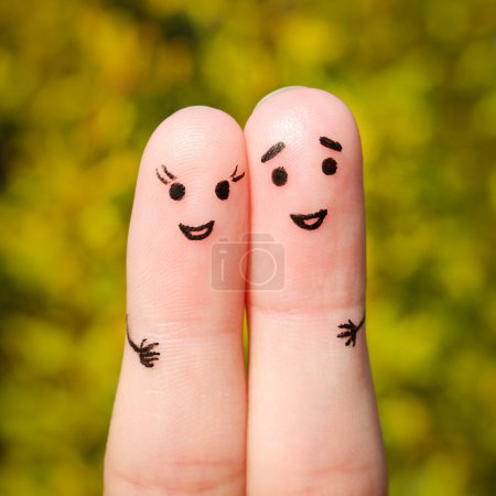 Finger art of a Happy couple. A man and a woman hug on the background of yellow leaves
