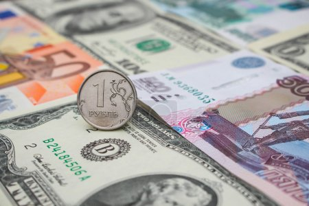 Russian ruble on the background money: dollars, euros, rubles
