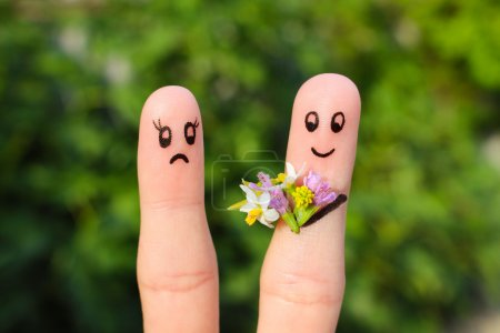 Finger art of couple. Joyful man gives a woman a bouquet of flowers, it is not satisfied.