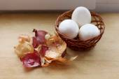 Eggs and peel from the onion.