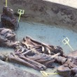 Archaeologists explore the huge tomb from the mid-...
