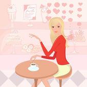 Szép nő, egy csésze kávét a cukrászda
