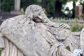 Régi szobor, a sírja a lychakivskyj temetőben a lviv, Ukrajnában