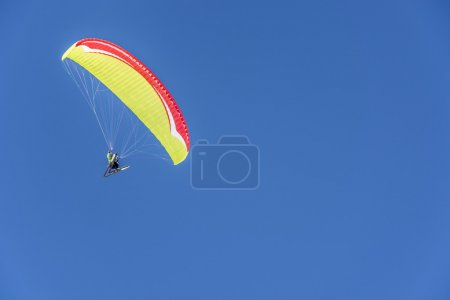 Paragliding skiers in the Alps.