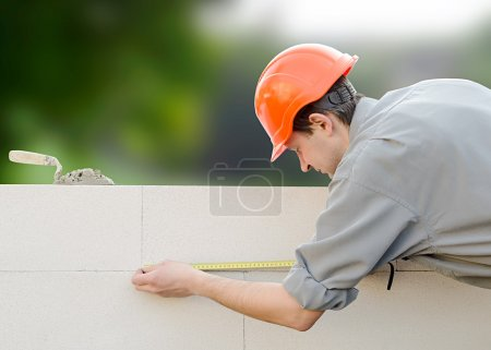 Photo for Builder erects a wall - Royalty Free Image