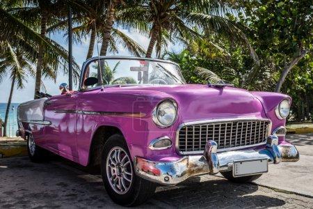 Pink Classic Car Parked Near The Beach In Cuba