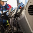 Firefighter with radios in a fire truck