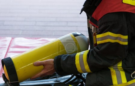 Oxygen cylinder in use with a firefighter...