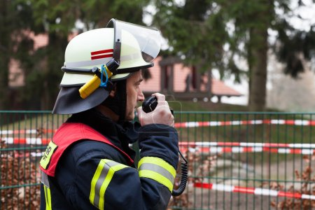 Firefighter with a mobile raido in his hand
