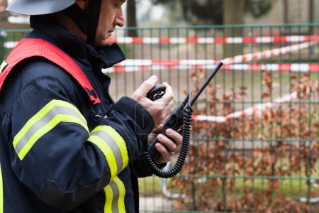 Firefighter with a mobile raido in his hand...