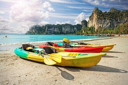 Kayaks on tropical beach, active holidays concept.