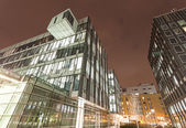 Modern business center in Warsaw at night.