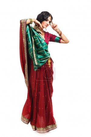 Beautiful young indian woman in traditional clothing, isolated on white background