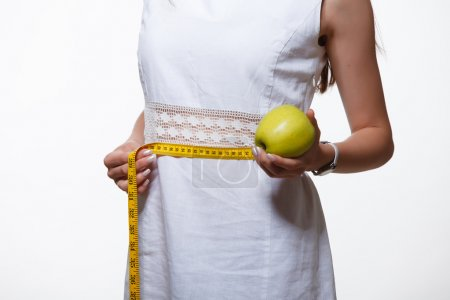 Photo for Woman hold scales, weightloss, fitness - Royalty Free Image