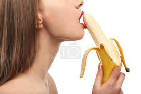 horny girl eats and licks the banana, oral sex