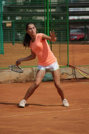 Beautiful young girl on the tennis court