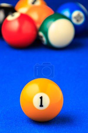 Billiard balls in a blue pool table.