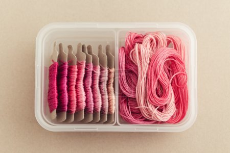 Photo for Embroidery Floss Storage in a plastic container - Royalty Free Image