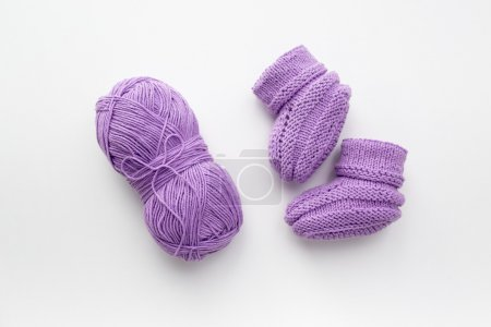 baby booties and pink yarn