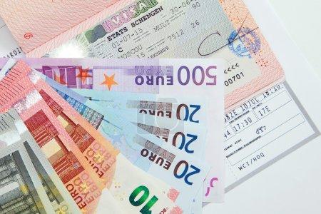 Visa, banknotes and boarding pass