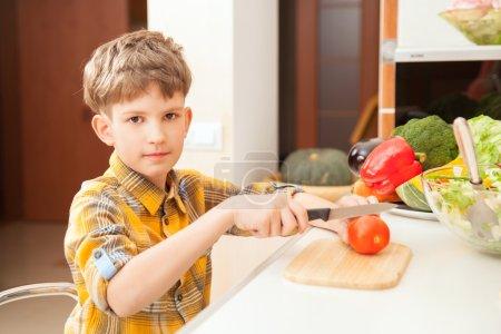 Boy preparing salad
