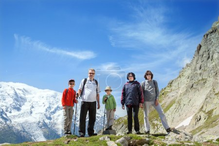 Family against massif of Mont Blanc
