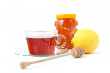 Photo pour Tasse de thé, miel et citron - image libre de droit