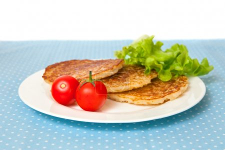 pancakes with tomatoes and salad