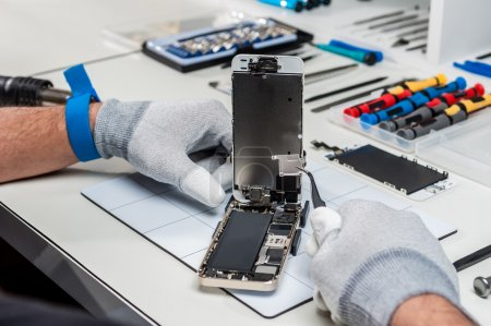 Photo for Close-up photos showing process of mobile phone repair - Royalty Free Image