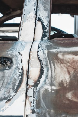 Rusted torched car detail....