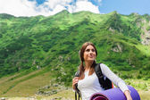 Young lady hiker with backpack enjoying view