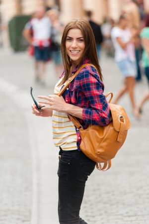 Young attractive woman traveling, visiting the medieval city.