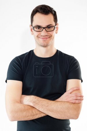 Portrait of a handsome and athletic man smiling with hands folded