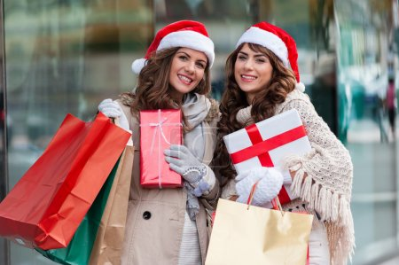 Girls at shopping for christmas, in the city