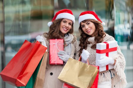 Two attractive young women shopping together