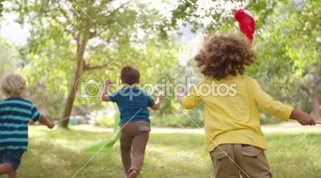 Children running in park with colorful banners