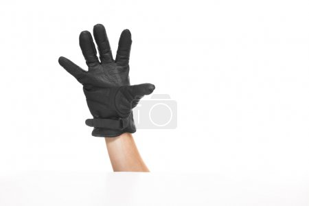 Photo for One hand isolated on white background with black leather gloves. Palm seems. - Royalty Free Image