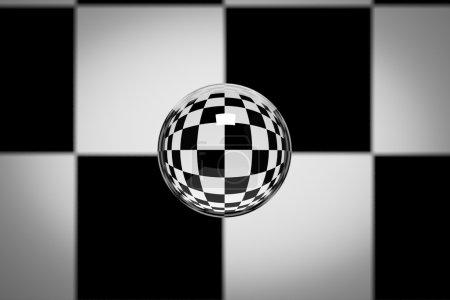 Photo pour Boule de verre sur fond de texture à carreaux . - image libre de droit
