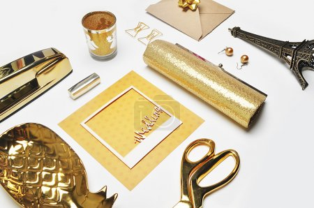 Flat lay. Woman accessories on the table, woman desk top. View top table, notebook and gold items.